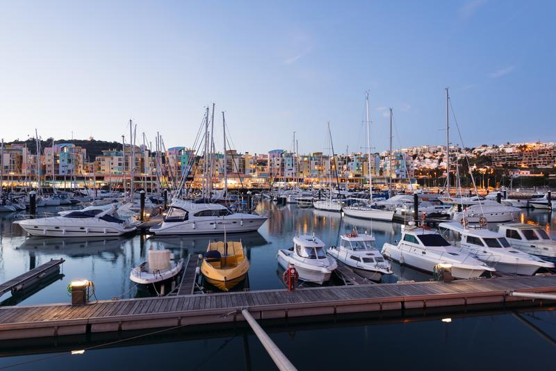 Albufeira Marina, Algarve, Portugal. Albufeira, Portugal - April 17: Night view of Luxury yachts and motorboats at the Albufeira Marina at Night. Albufeira is a royalty free stock photos