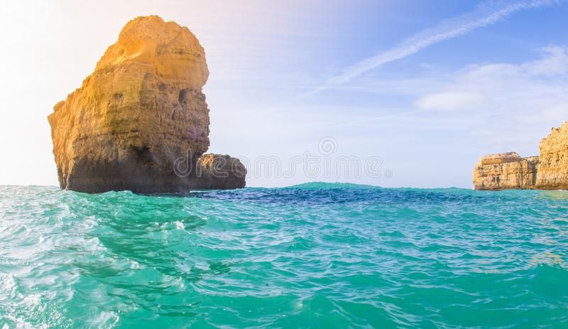 A boat ride shows the rocky coast of the algarve stock image
