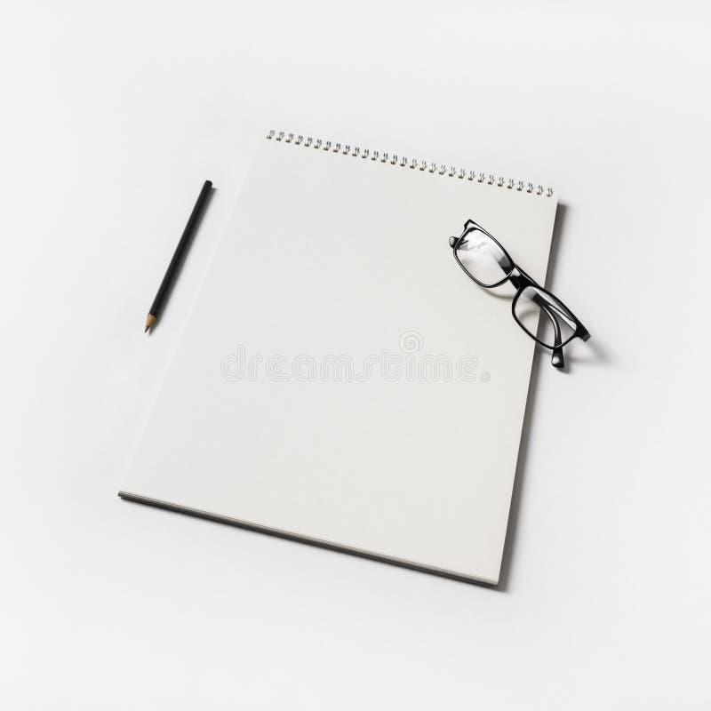 Album, glasses, pencil stock image
