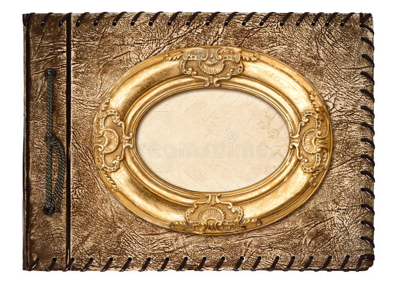 Album photos de cru couverture en cuir et cadre d'or image libre de droits