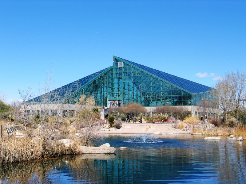 Albuquerque Botanical Gardens. The glass building houses a wide variety of flowers on the right side and cactus on the left. The location of it is, 903 Tenth royalty free stock image