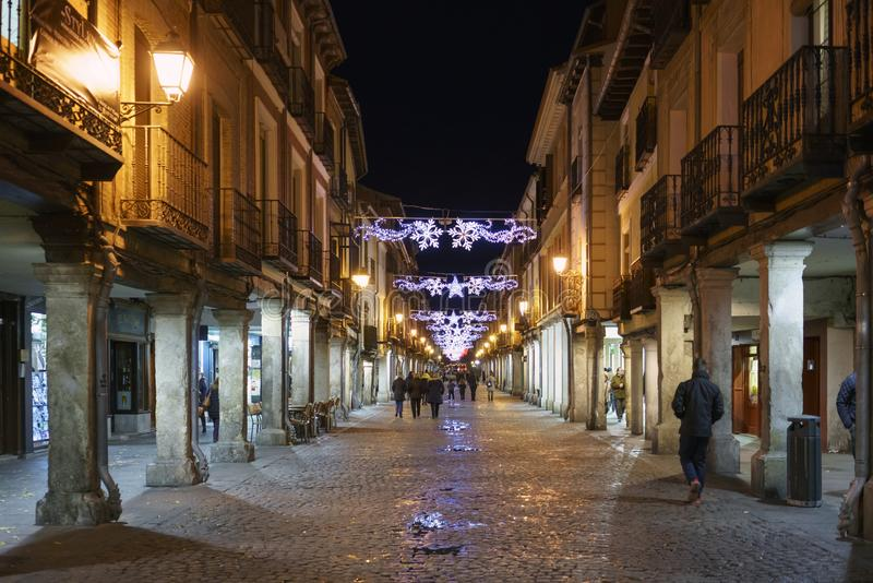 Alcala de Henares, Madrid, Spain / December 1, 2017: Night photo. Of a street in the center of town with Christmas lights, people walking and shopping shortly royalty free stock images