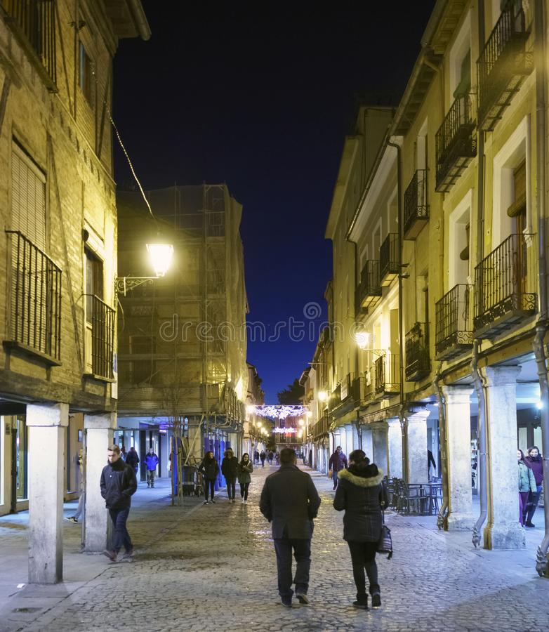 Alcala de Henares, Madrid, Spain / December 1, 2017: Night shot. Of a street in the center of town with Christmas lights, people walking and doing shopping on a royalty free stock photos