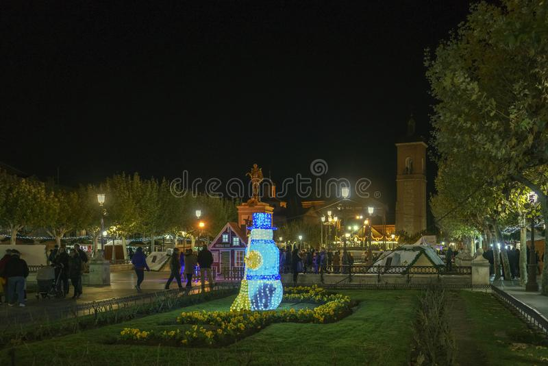 Alcala de Henares, Madrid, Spain / December 1, 2017: Night shot. Of a general view of the square called `de Cervantes` with a view of a simulated Christmas stock photo