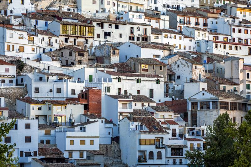 Houses and roofs next to mountain limestone, view to the mountains of the river Jucar, take in Alcala del. Alcala del Jucar, Spain - October 29, 2016: Houses and royalty free stock image