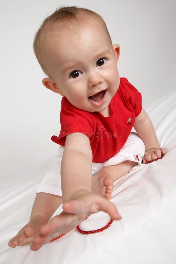 Alcance do bebê imagem de stock royalty free