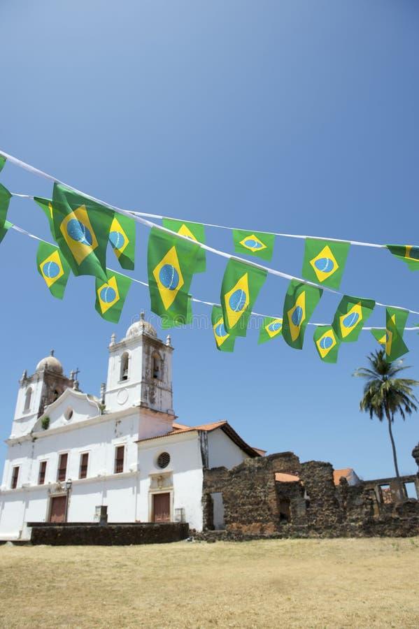 Alcantara Brasil White Colonial Church Nordeste with Brazilian Flag Bunting. Alcantara Nordeste Brasil white colonial Carmo church with Brazilian flag bunting royalty free stock image