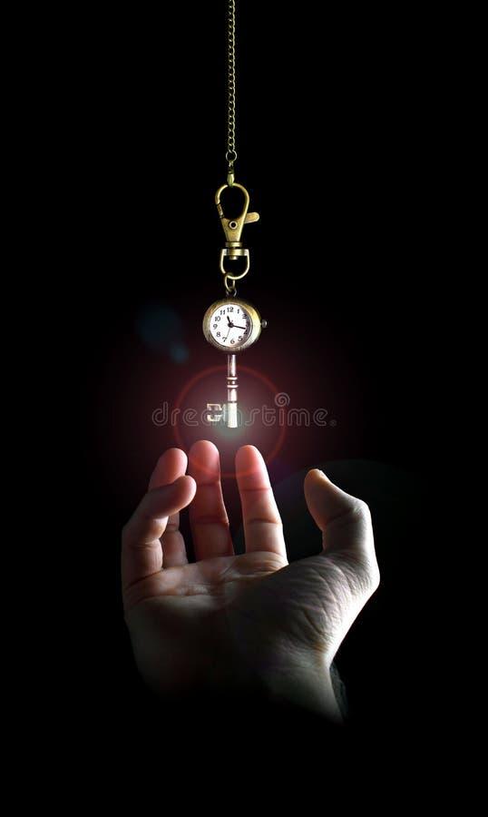 Alcanzar el clave del tiempo foto de archivo libre de regalías
