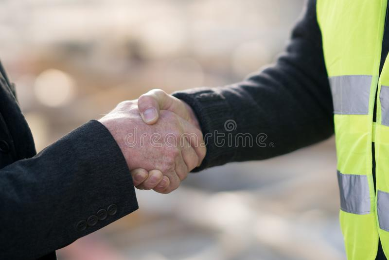 Alcanzar un acuerdo en emplazamiento de la obra imagen de archivo