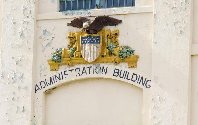 Alcatraz Administration Building, San Francisco, California. A statue of the government Seal depicting the bald eagle, coat of arms and american flag at the stock images