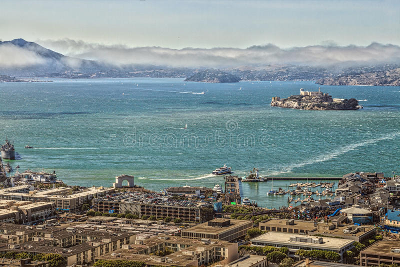 Alcatraz aerial view. San Francisco, California, United States - August 14, 2016: Aerial view of Alcatraz Island, Hyde Street Pier in Fisherman`s Wharf and stock photo