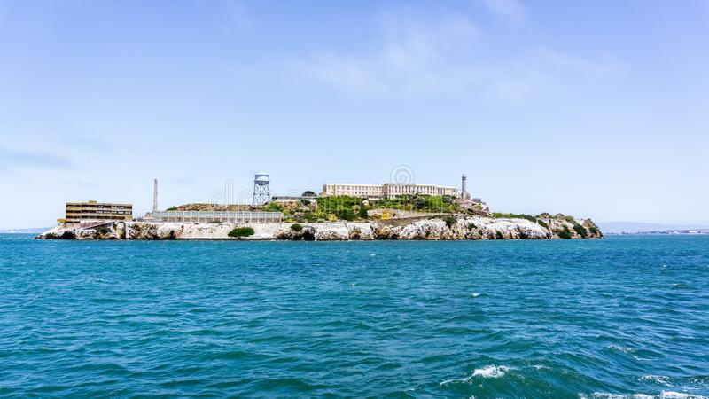 Alcatraz Island, home to the abandoned prison, the site of the oldest operating lighthouse on the West Coast of the United States. And early military royalty free stock photos