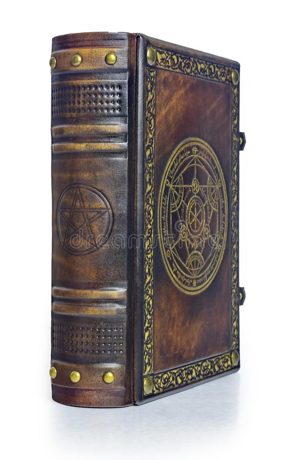 Alchemy leather book with gilded transmutation circle in center of the front cover, attributed to a German alchemist from the 17th. Century. Captured isolated stock image