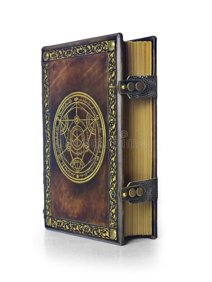 Alchemy leather book with transmutation circle in center of the front cover, attributed to German alchemist from the 17th century. Alchemy leather book with stock photography