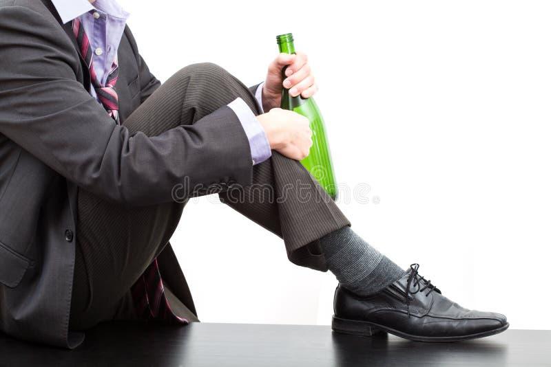 Alcoólico com a garrafa do vinho imagens de stock royalty free
