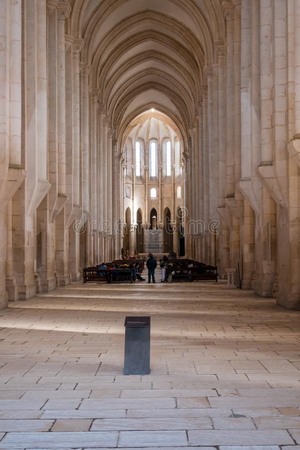 Central nave. Alcobaça, Portugal - March 8, 2019 : View of the central nave in Gothic style at Alcobaça Monastery, Portugal royalty free stock photos
