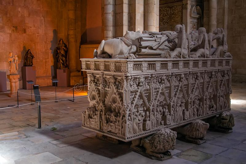 Alcobaca, Portugal - July 17, 2017: Gothic Tomb of King Dom Pedro with recumbent effigy. Monastery of Santa Maria de Alcobaca. Abbey. Funerary art Masterpiece stock photography