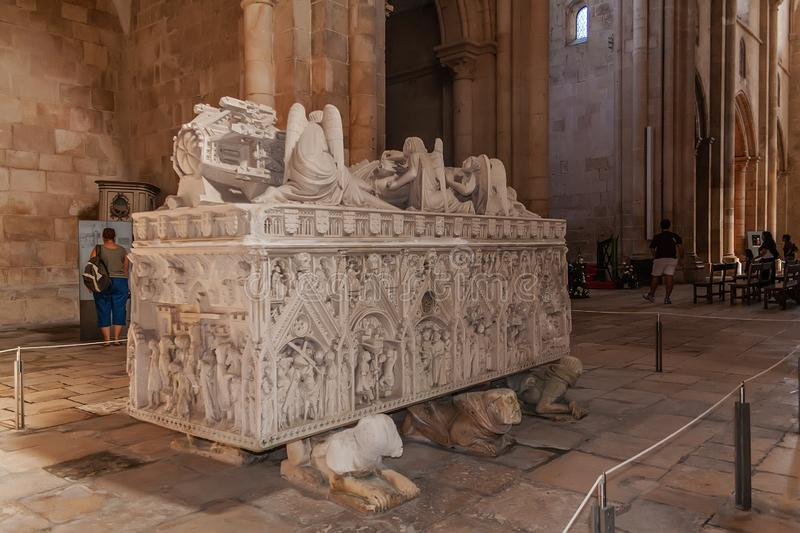 Alcobaca, Portugal - July 17, 2017: Gothic Tomb of Queen Ines de Castro with recumbent effigy and angels. Monastery of Santa Maria. De Alcobaca Abbey. Funerary royalty free stock photos