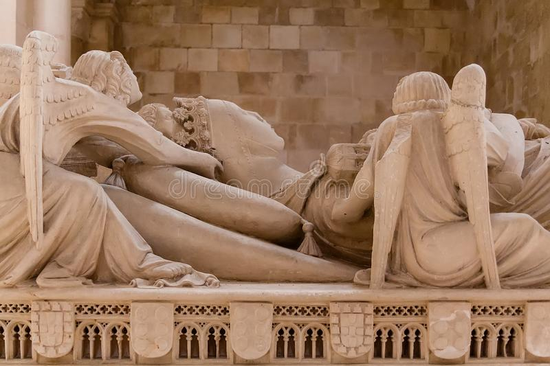 Alcobaca, Portugal - July 17, 2017: Gothic Tomb of Queen Ines de Castro with recumbent effigy and angels. Monastery of Santa Maria. De Alcobaca Abbey. Funerary royalty free stock photography
