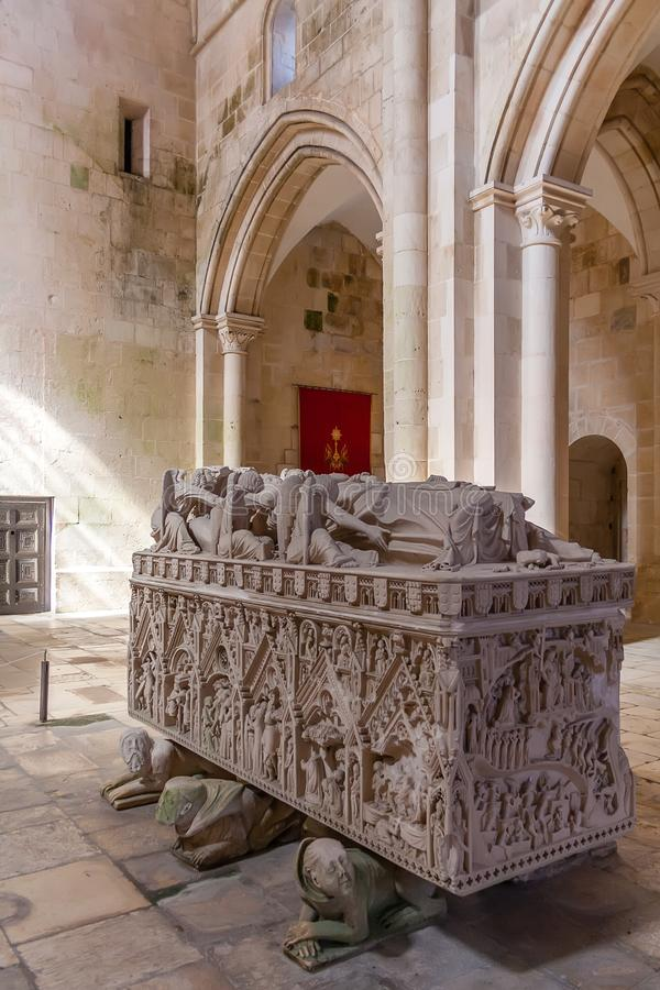 Alcobaca, Portugal - July 17, 2017: Gothic Tomb of Queen Ines de Castro with recumbent effigy and angels. Monastery of Santa Maria. De Alcobaca Abbey. Funerary royalty free stock image
