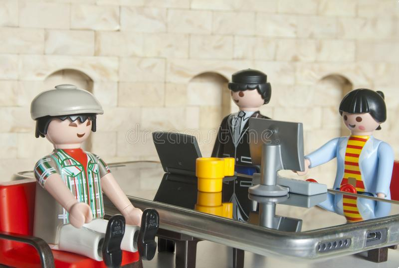 Alcobendas, Spain. October 12, 2018 Interview of an asiatic man in an office. Concept,Playmobil toy line exist since 1975 and is royalty free stock photos