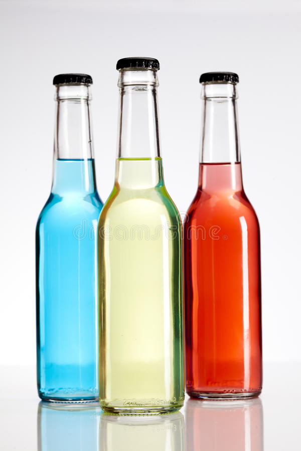 Alcohol. Exotic bottle alcohol cocktail isolated on white stock photos