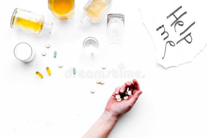 Alcohol abuse. Drunkennes. Words Help me near glasses and bottles on white background top view copy space stock photos