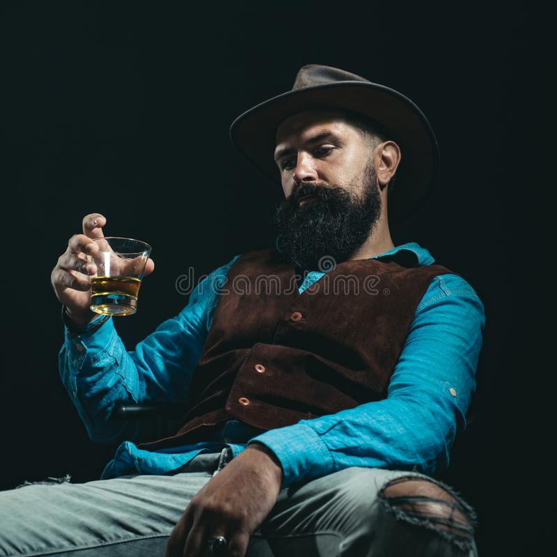 Alcohol addict. Attractive man in whiskey bar. Hipster with beard and mustache in suit drinks alcohol after working day. Diverse young people. Bring down royalty free stock photos
