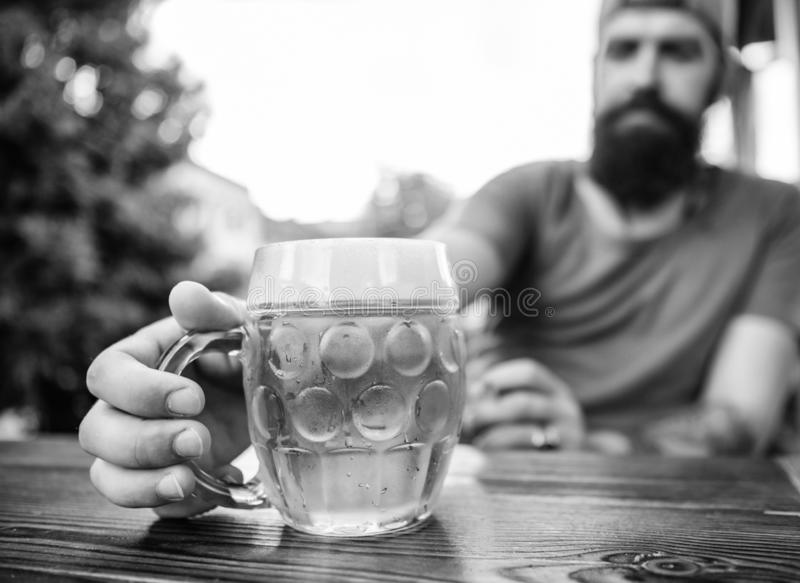Alcohol and bar concept. Creative young brewer. Craft beer is young, urban and fashionable. Distinct beer culture. Mug. Cold fresh beer on table close up. Man royalty free stock image
