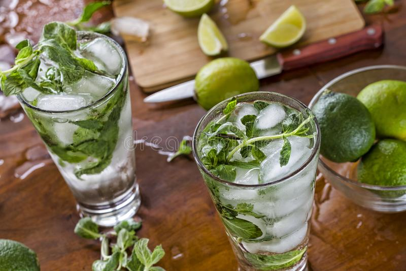 Alcohol, beverage, cocktail, cold, cool, green, ice, juice, lime, mint, mojito, summer, citrus, drink, fresh, fruit, glass, rum, royalty free stock image