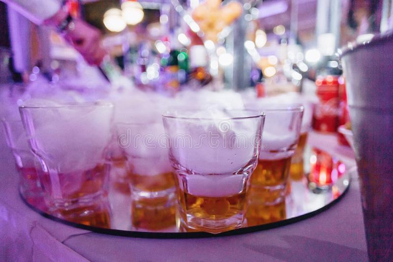 Alcohol at celebrations in glasses and buffets. Alcohol at celebrations in glasses and festive buffets stock images
