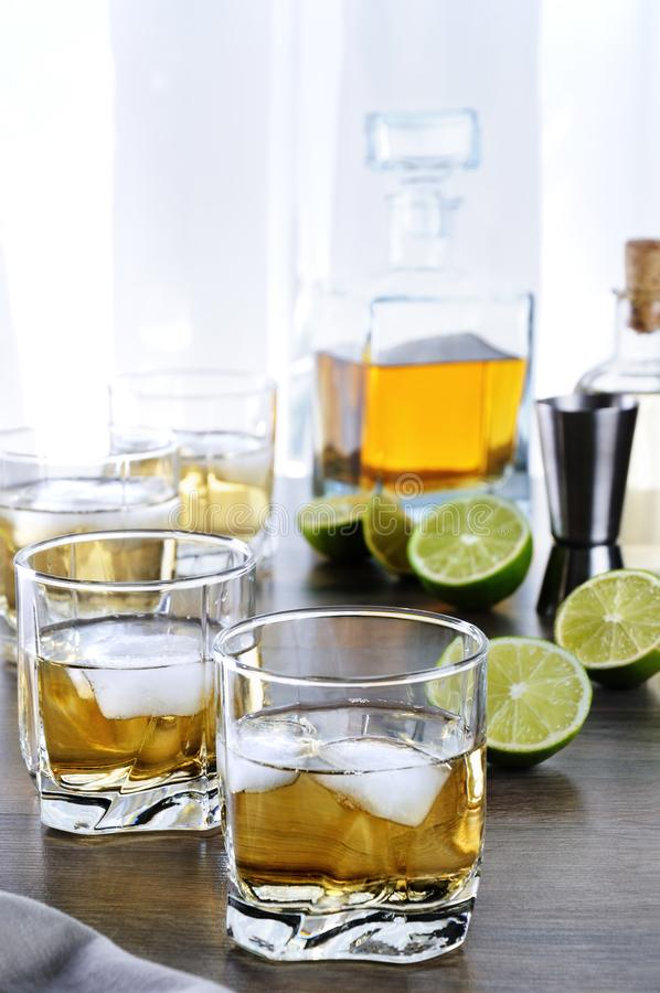 Alcohol cocktail. With brandy, whiskey or rum with Ginger Ale, lime and ice in glasses royalty free stock photo