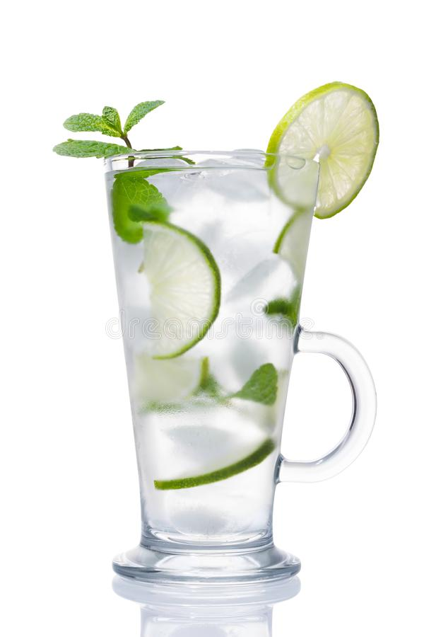 Alcohol coctail with ice, lime and mint stock photos