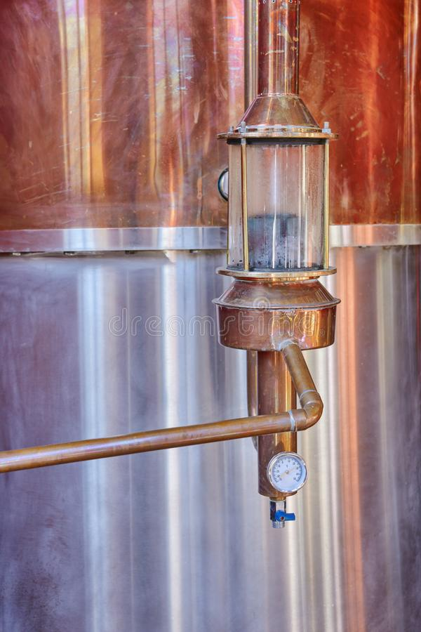Alcohol copper still alembic details royalty free stock photos