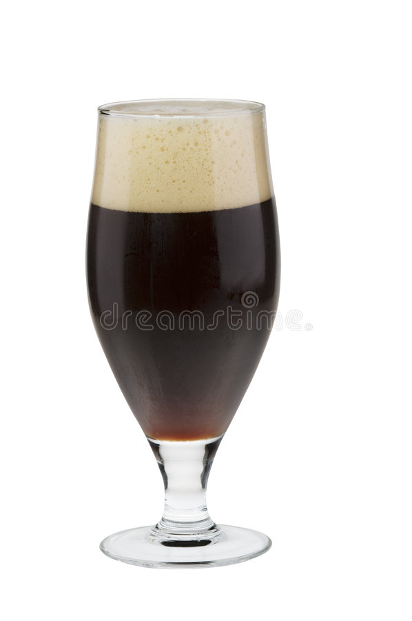Alcohol dark beer glass with froth isolated royalty free stock photos