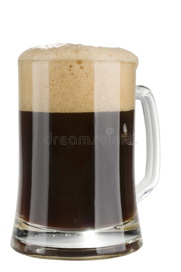 Alcohol dark beer glass with froth isolated stock photography