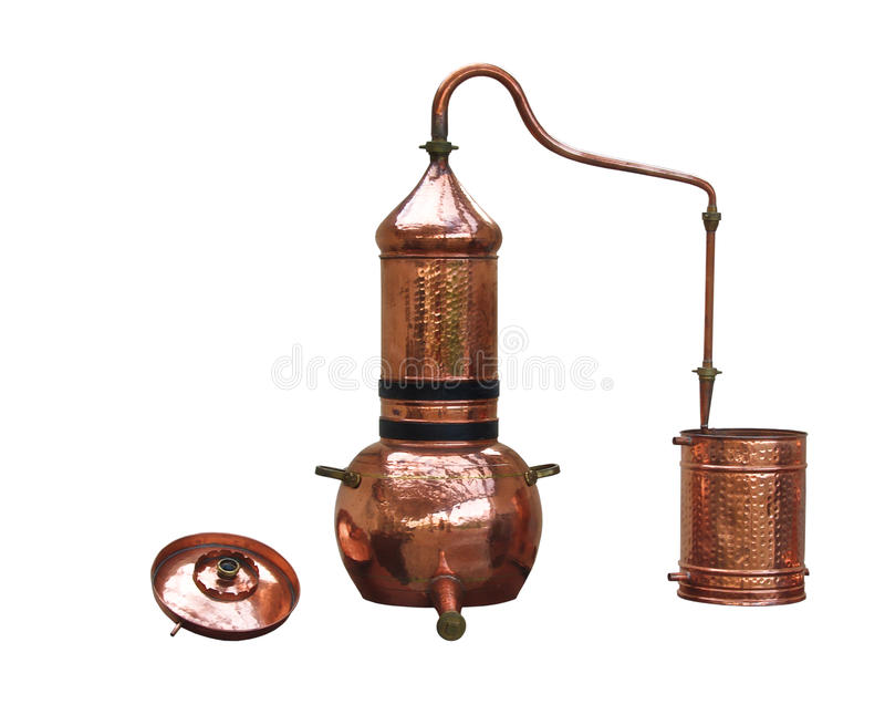 Alcohol distillery. Perfume & alcohol distillery. Alembic Copper - Distillation apparatus employed for the distillation of alcohol, essential oils and moonshine stock photos