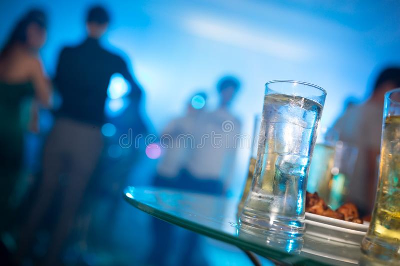 Alcohol glass drink in party, cocktail glass on bar counter, Cocktail in the glass with straws, Fresh drink. royalty free stock photography