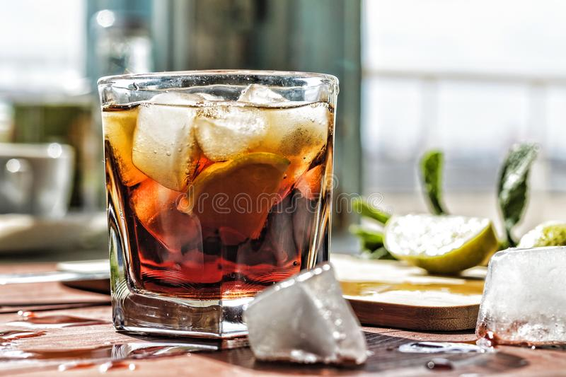 Rum, alcohol, glass, cocktail, drink, background, closeup, ice, lime, beverage, royalty free stock photography