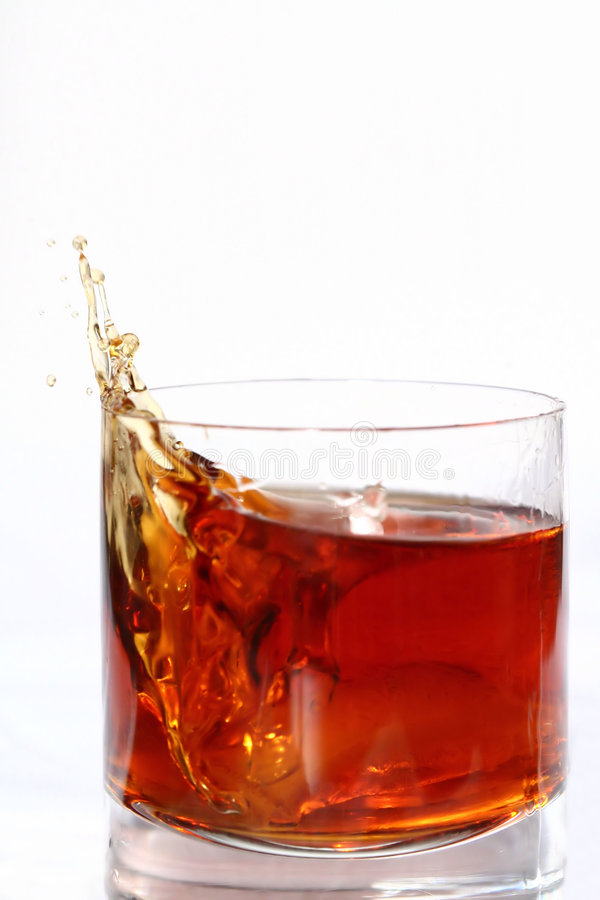 Alcohol Splashing out of Glass stock images