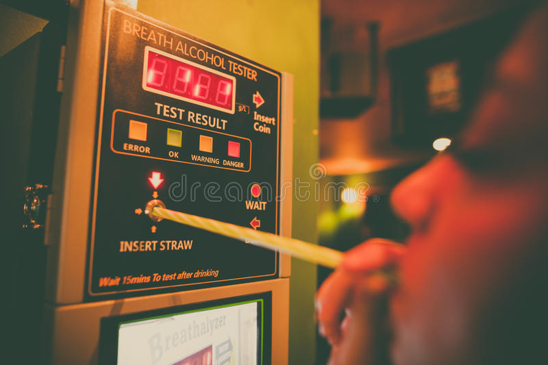 Alcohol tester on a wall stock images