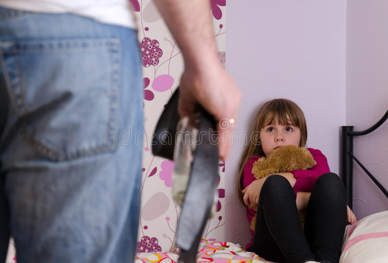 Alcohol violence family problems. Scared daughter because of father anger after alcohol drinking stock photo
