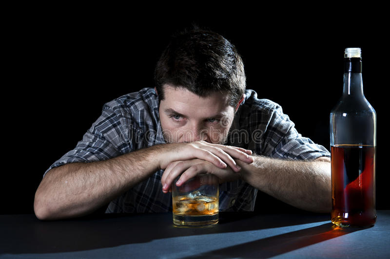 Alcoholic addict man drunk with whiskey glass in alcoholism concept stock photos