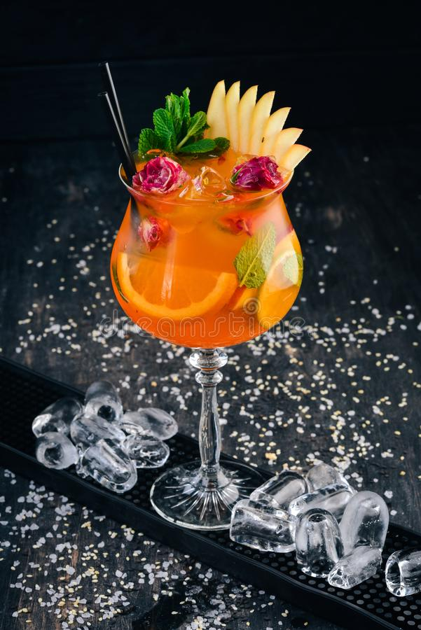 Alcoholic Cocktail Aperol Spritz with Roses. royalty free stock images