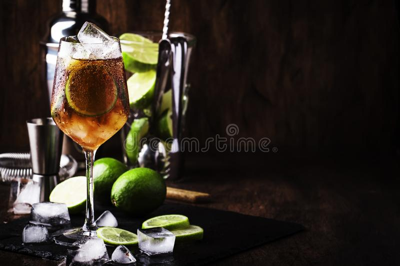 Alcoholic cocktail Long Island with vodka, gin, tequila silver, white rum, liqueur, sugar syrup, lemon juice, cola and ice cubes, royalty free stock photo