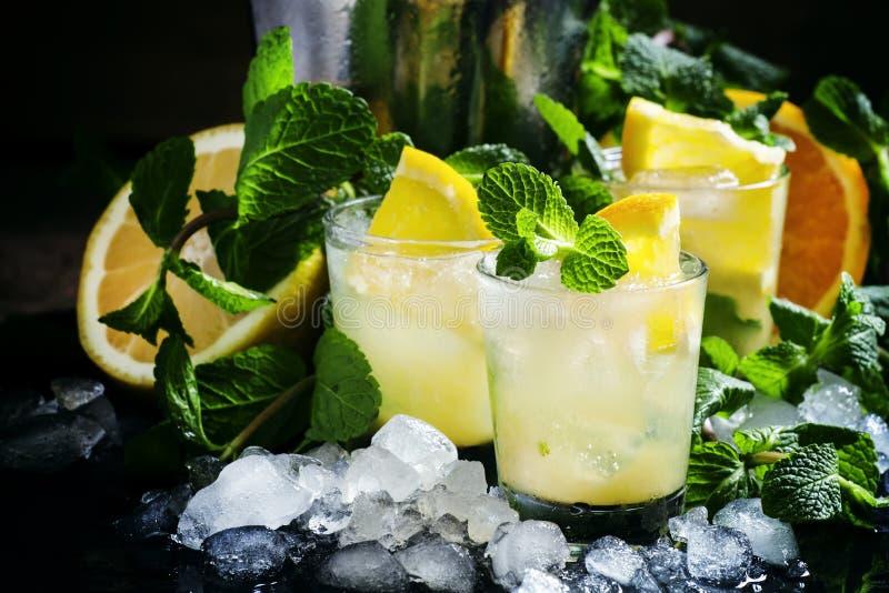 Alcoholic cocktail Morocco smash with Scotch whiskey, sugar syrup, orange, lemon, mint leaves and crushed ice, black stock image