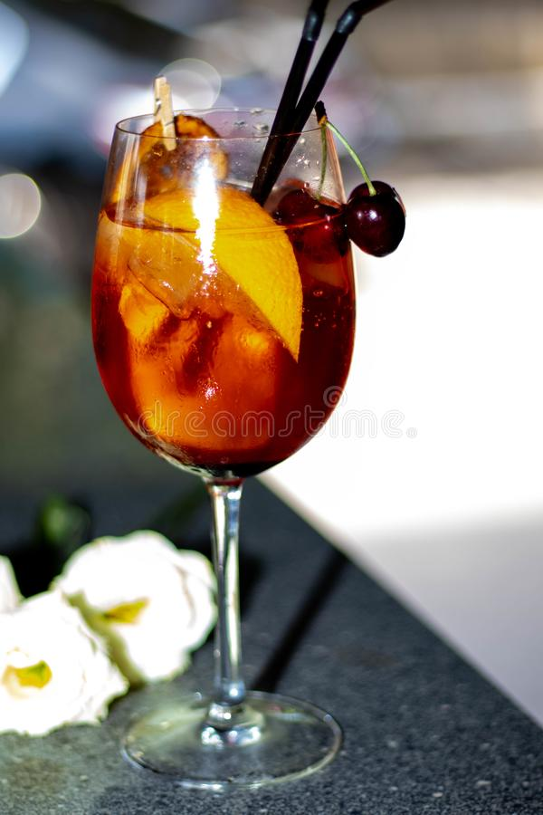 Alcoholic cocktail in a transparent glass on a thin leg. royalty free stock photography