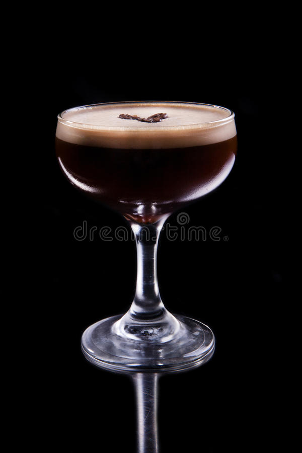 Alcoholic coffee summer recreational cocktail. Black background stock image