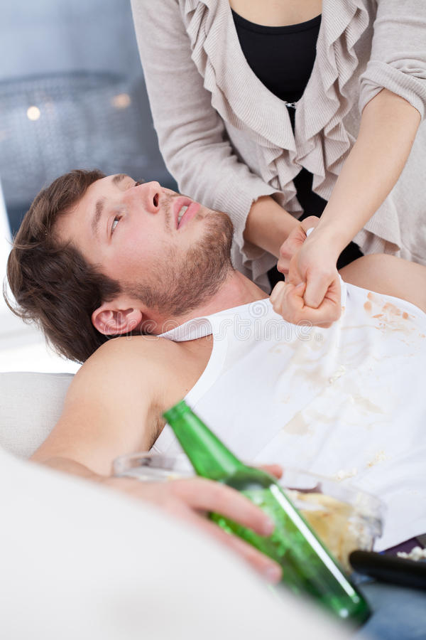 Alcoholic doesn't want to help wife stock photo