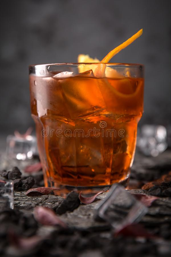 Alcoholic or non-alcoholic cocktail with orange citrus, pomegranate with the addition of liqueur, vodka, champagne or martini. Cool drink. Easy Bartenders stock images
